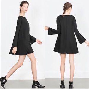 ZAZA TRAFALUC WOMAN BLACK BELL DRESS.